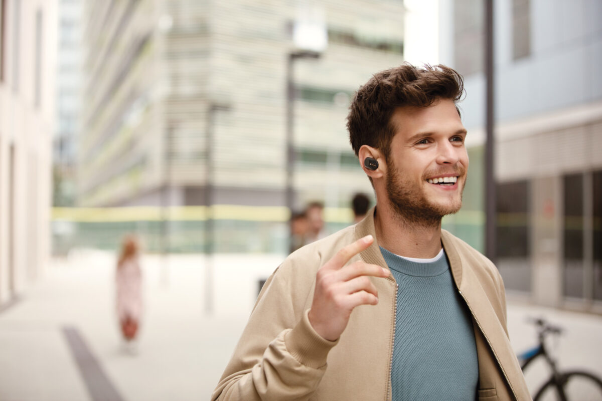 Young man wearing Sony WF-1000XM3 earbuds